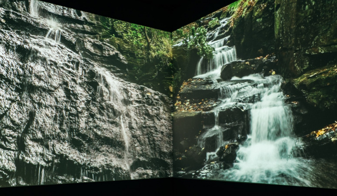 Two images of waterfalls on 2 adjoining walls