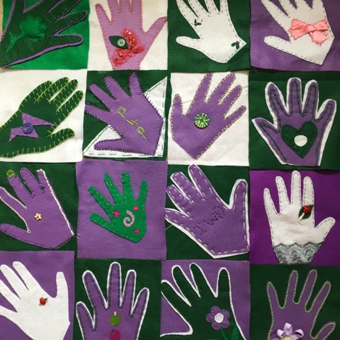 Image shows 12 outlines of hands, each contained with a square on a square grid. The hands are either white, purple, or green with a contrasting choice of these colours in the background.