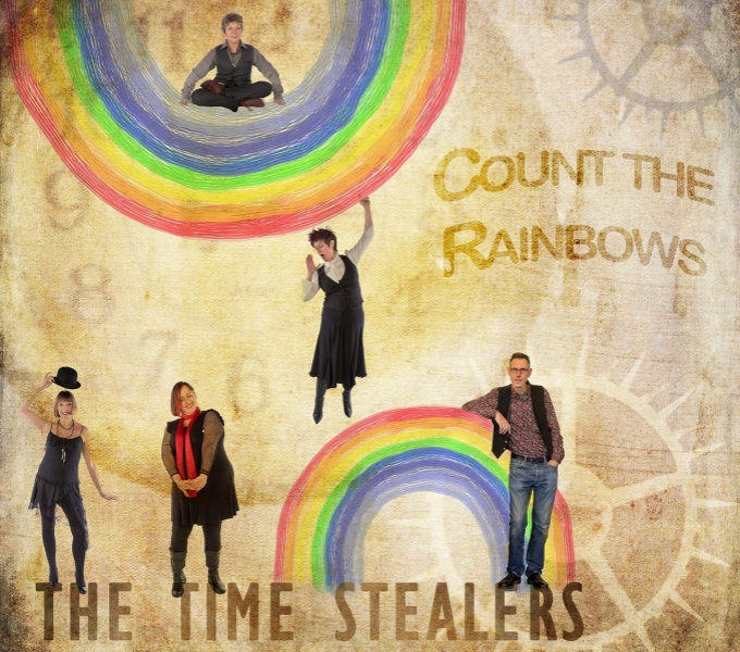 Five band members shrunk in size against a light background of clocks and cogs and two painted rainbows