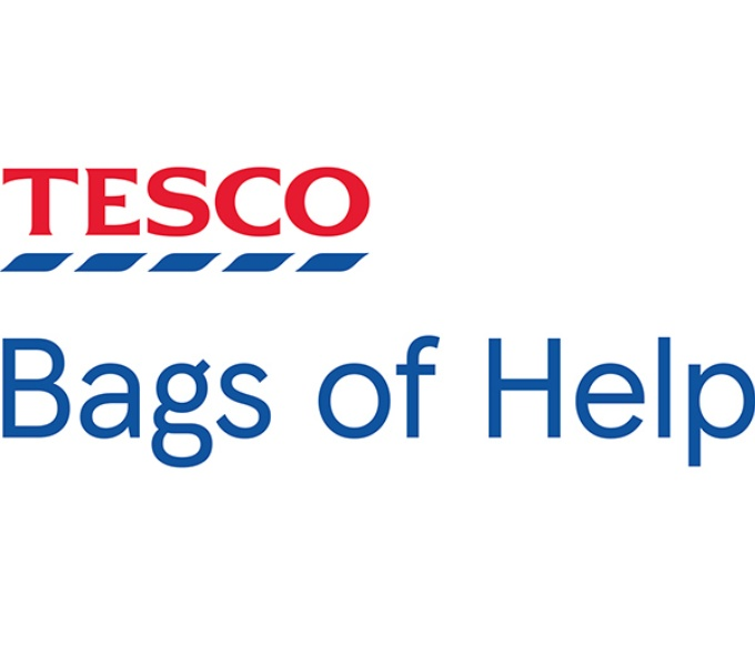 Red Tesco logo with broken blue line beneath and the words Bags of Help written in blue below