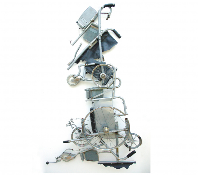 A photograph of a collection of wheelchair parts arranged in the shape of the map of Great Britain.