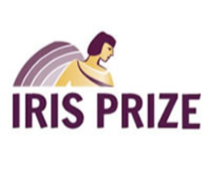 In Capital purple letters it reads 'Iris Prize', with the head and shoulders of a woman with dark hair and large wings, looking down and to the right