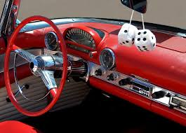 An image of a car dashboard from a 1950s style car