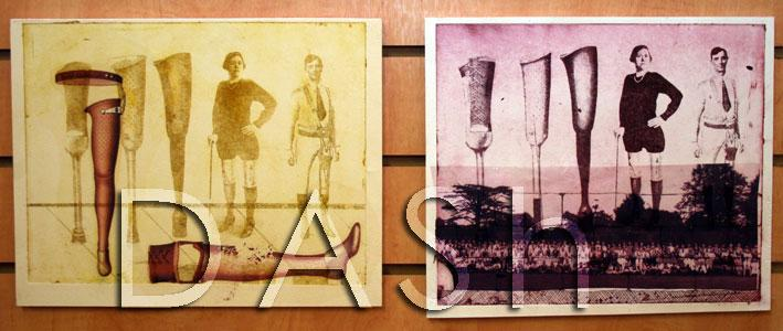 The photograph shows two prints hung on a wooden wall.  The first image on the left is landscape format and shows various types of artificial legs, in the image are a man and a woman modelling the artificial legs.  The image has been printed in yellow and overprinted in brown ther are two further artificial legs, on of the legs is prostrate.  In the right hand image, also in landscape format, the smae print is used in the background but the colour is deep pink, the image has been overprinted with a landcspe imae of trees.  Both of the prints were made by David Burns for the Barriers project.  Photograph by Paula Dower copyright DASh.