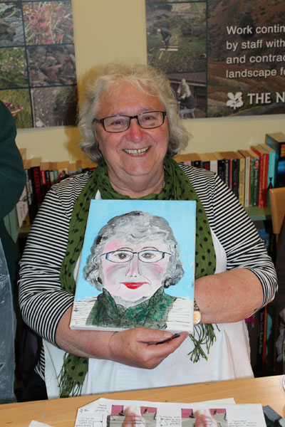 Workshop participant showcases their completed portrait painting