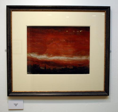 A red sky with a white highlight threequarters of the way down, with city skyline in silhouette. Pastel by Rob Gemmell. Photograph by Paula Dower copyright DASh