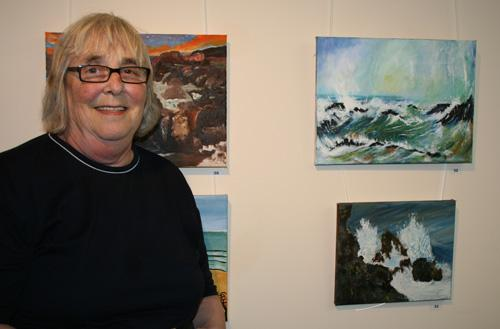 Ann Patterson with her painting - bottom left seascape
