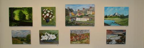 Eight paintings in oils and acrylics left to right, top to bottom by - John Wilson - Woodland Walk in Spring - Carnations,  Daphne Dunkasson - View from Louise's Attic Flat, John Wilson - Distant Peaks,  Margaret Wilson- South Shropshire Hills - Magnolias, Angela Baker - Walk to the Village after Pissaro, Margaret Wilson - Elgol, Isle of Skye
