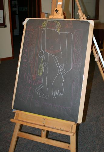Life drawing by Jonathan White using coloured pastels on black paper