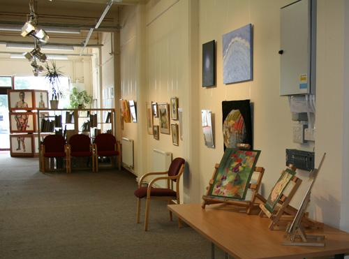 View of the DASH SPACE with art on the walls
