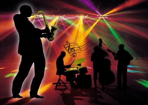 Photoshop Workshop November 9th and 10th 2011.  Image by Margaret Wilson - Musicians are in silhouette, with coloured lights creating rays of red,green, yellow and pnik colour in the background. Copyright Margaret Wilson.