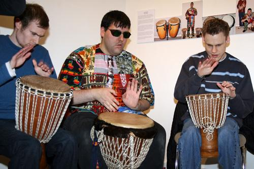 The photgraph shows three musicians drumming on African drums.  Left to right Joe, Richard and Martin. Photograph by Paula Dower copyright DASh