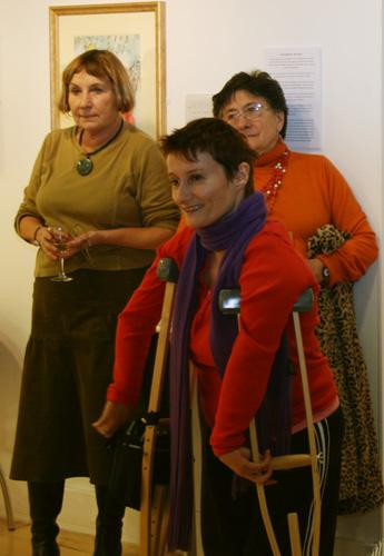 Three women standing at the Artists Development Team 3 exhibition at the Qube gallery. photograph by Paula Dower copyright DASh